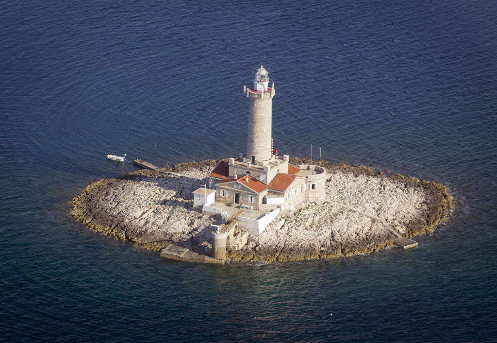 In this photo taken June 17, 2013, a lighthouse Porer in northern Adriatic is photographed from the air. The lighthouse is used for tourist accommodation. On Monday July 1, 2013, Croatia will become the 28th EU member, the bloc's first addition since Bulgaria and Romania joined in 2007. Croatia's membership marks a historic turning point for the small country, which went through carnage after declaring independence from the former Yugoslavia in 1991. (AP Photo/Darko Bandic)